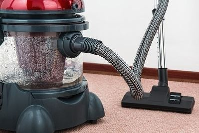 cleaning machine sitting on the carpet